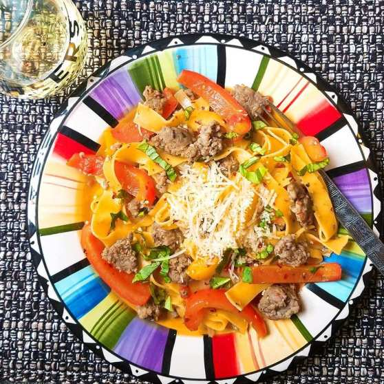 Italian Drunken Noodle With A Glass Of Chardonnay