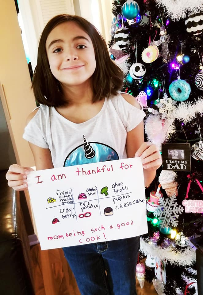 Chloe with her drawing about what she is thankful for