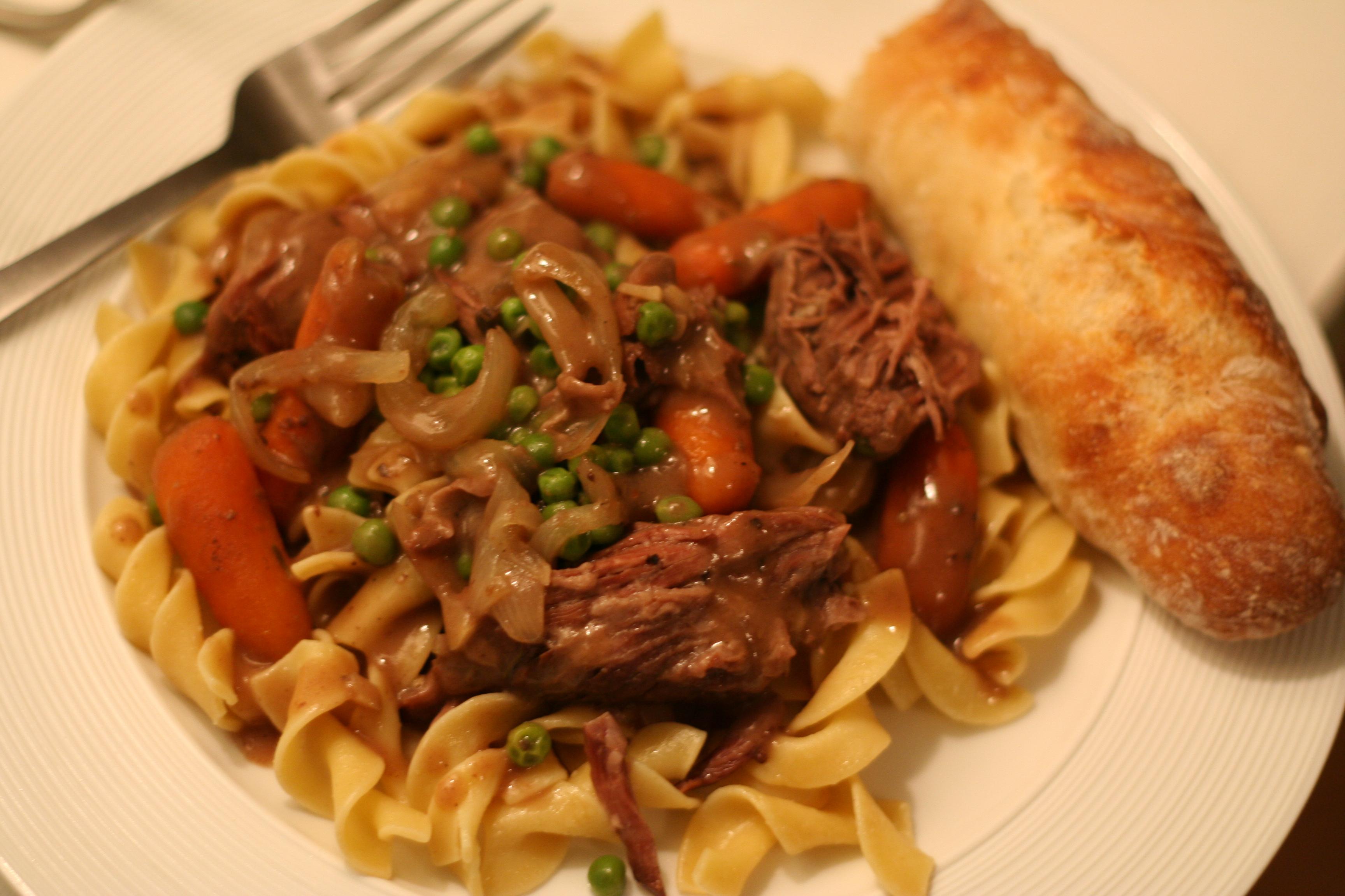 pot roast over egg noodles with gravy