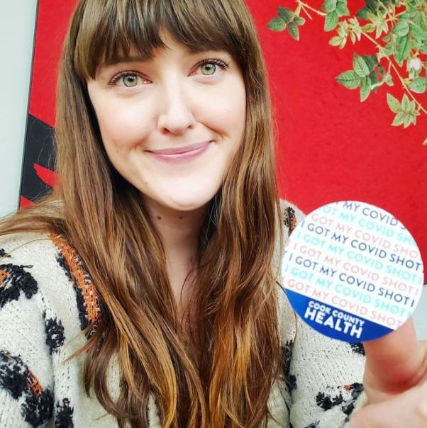 """Picture of me holding my """"I'm vaccinated"""" sticker in Chicago, IL."""