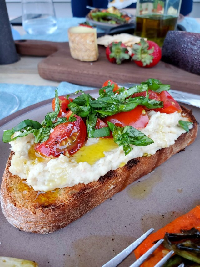 Vegetarian Recipe for White Beans + Roasted Garlic on Grilled Bread with Tomaatoes and Basil