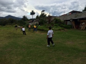 Pastor Santiago Rosales plays soccer with some men of the church.