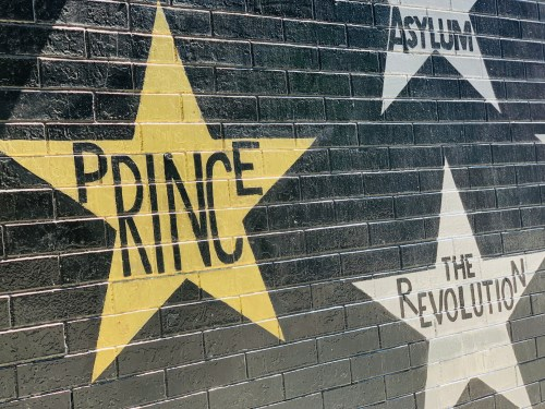 On the side of First Avenue in Minneapolis, a gold star is painted on the building with the name of music legend Prince.