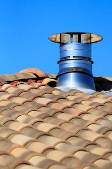 Metallic chimney cap