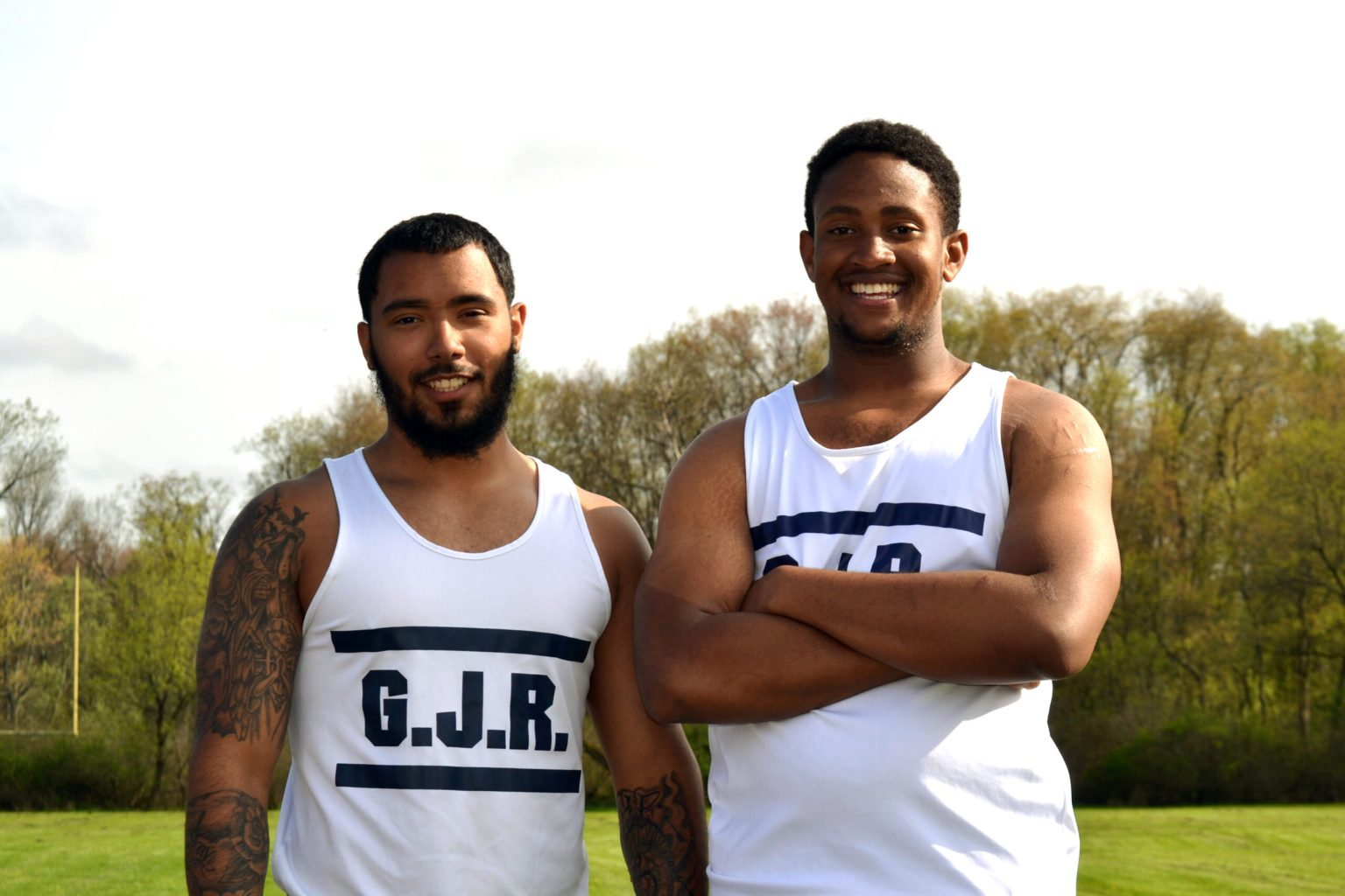 two track and field athletes smiling