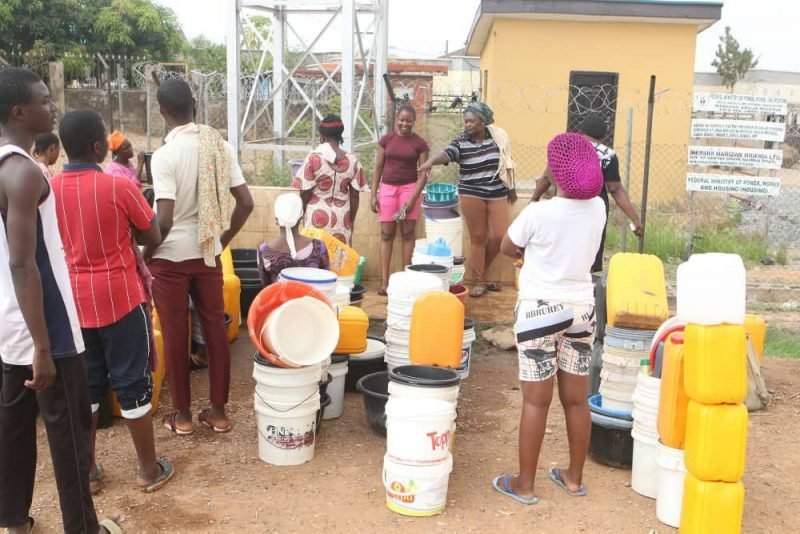 Abuja Residents Forced To Fetch Water From Streams Due To Water Scarcity (Photos) 7