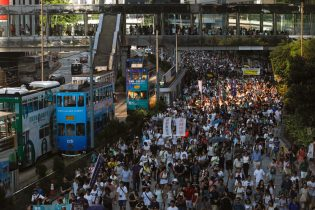 Tens of thousands protest in Hong Kong over jailing of democracy activists