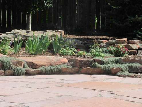 Patio with Moss Rock Wall and Thyme Longmont