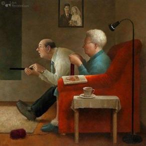Äldre par i röd soffa kul kopia