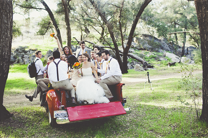 bridal party in the back of a pickup | Sarah Kathleen