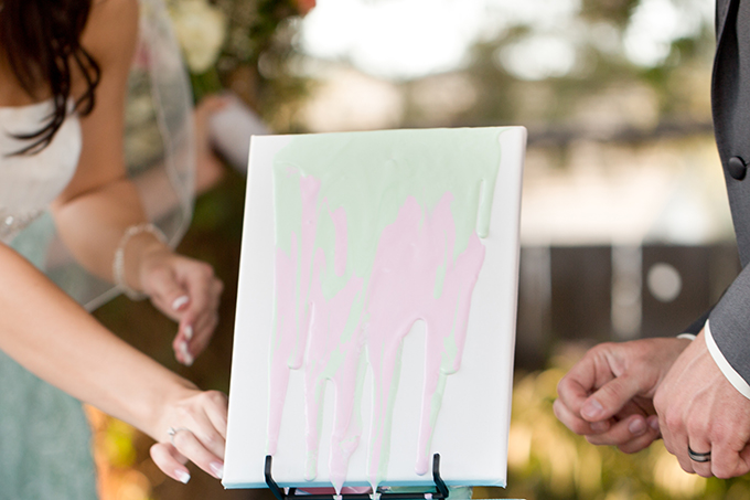 painting a canvas for a 'unity painting' | Amy & Jordan Photography