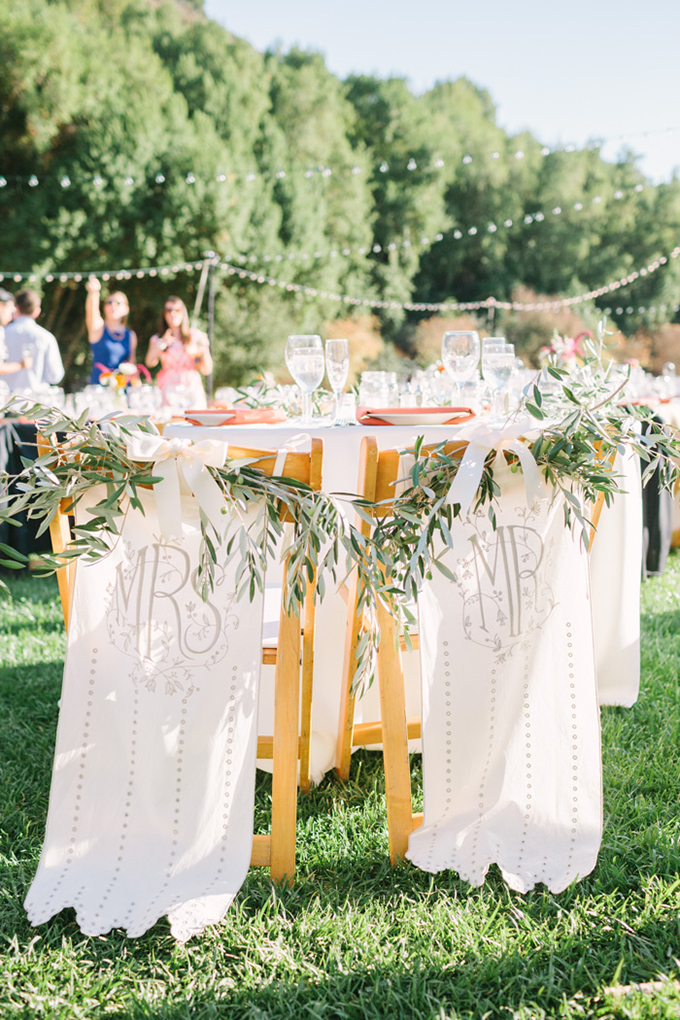 BHLDN Mr and Mrs chair covers | Kirsten Julia Photography | Glamour & Grace
