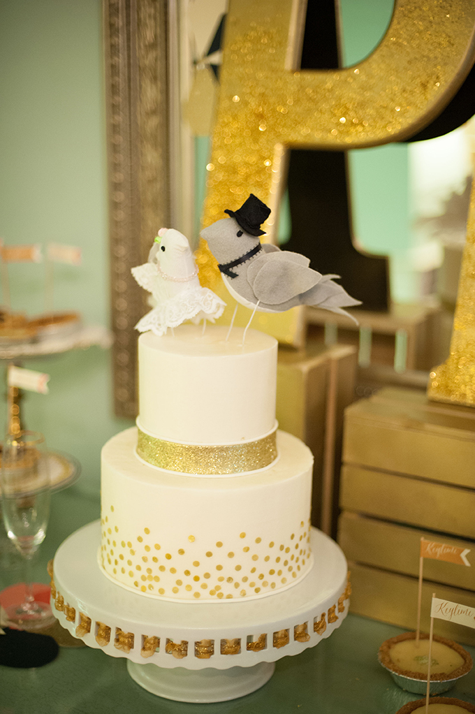 gold cake with bird topper | Stephanie A Smith Photography | Glamour & Grace