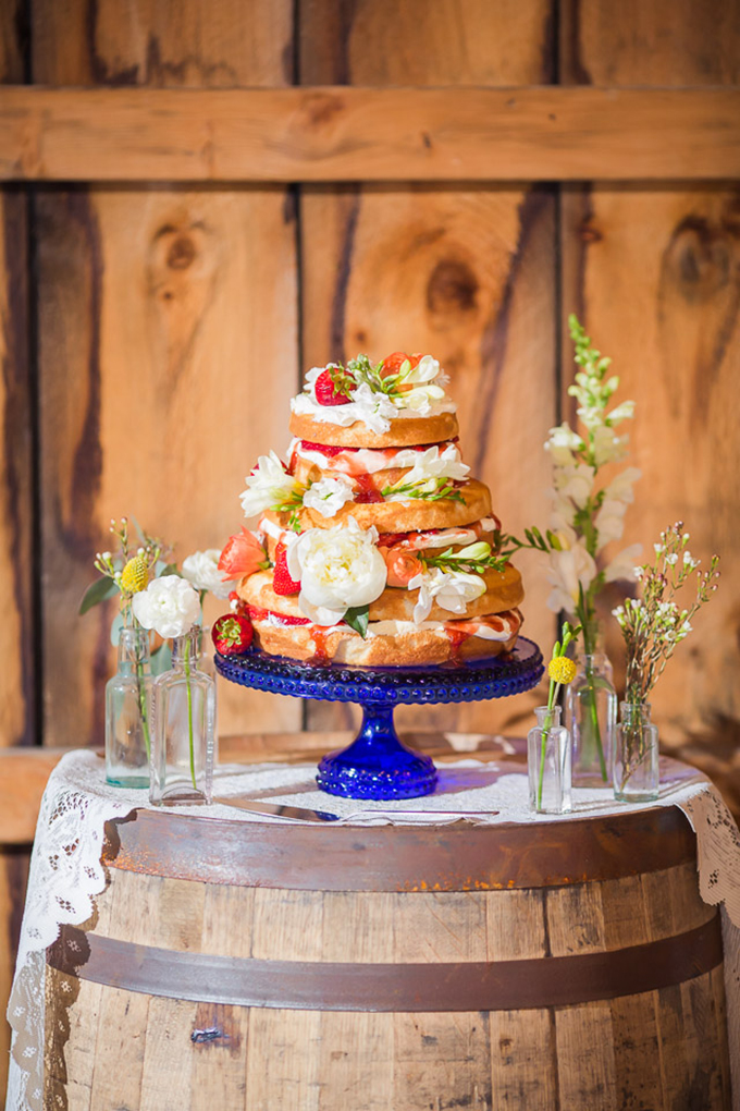 floral covered naked cake | Jaclyn Schmitz Photography | Glamour & Grace
