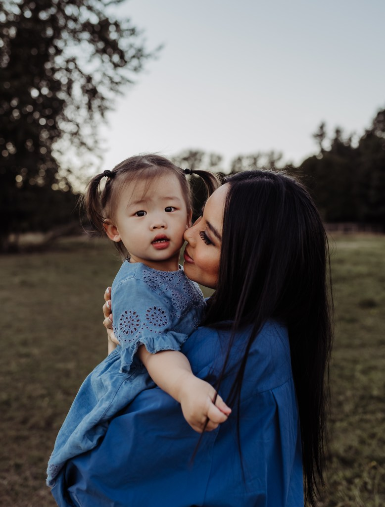 mother and daughter kiss