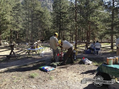 Volunteer tree planting at campground, National Public Lands Day.