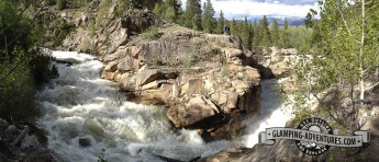 The raging river flowing around the rocks. Along Independent Pass.