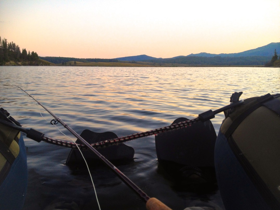 Fly fishing in the evening sunset. Steamboat Lake, CO.