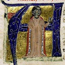Die Troubairitz (= weibliches Gegenstück des Troubadours) Comtessa de Dia (oder Beatriz de Dia / Mitte 12. Jh.) in einer Initiale-Abbildung. Die einzige überlieferte Melodie einer Trobairitz stammt von ihr.