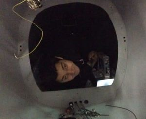 Assembly Tech Tony Hatziliadis gazing back through the Bulkhead A hatch.