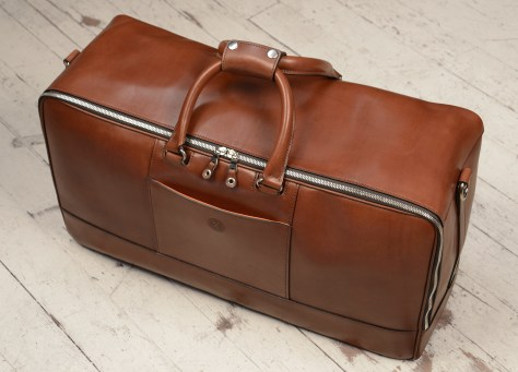 Hand-burnished-espresso-Square-Duffel-with-open-front-pocket-and-tangerine-lining;-22-x-12-x-8'-topdown1