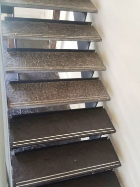 Natural Rough Slate Tiled Stairs Touch Estate During Sealing