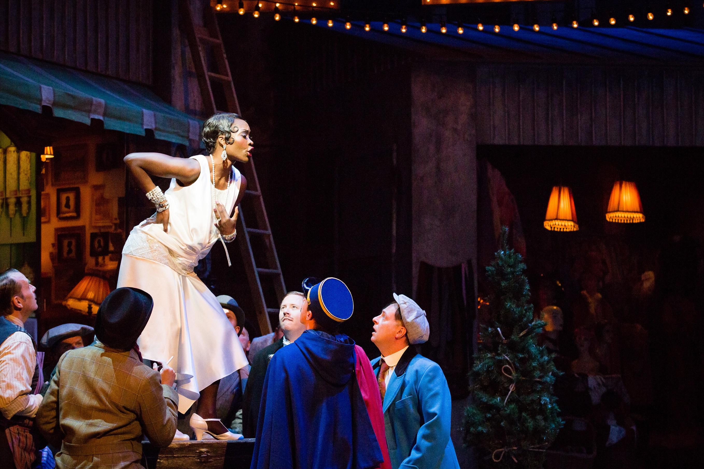 a woman in flapper dress atop a table in la boheme