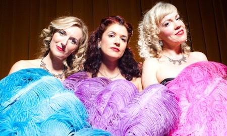 the swingcats with feather fans