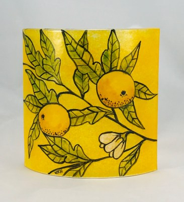 Fused glass curved panel of oranges and foliage