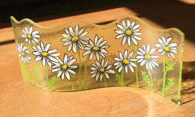 Long wavy fused glass panel with hand painted daisies
