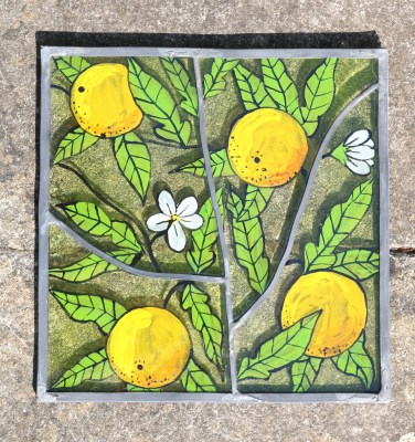 Handpainted oranges on green glass with leaded joints
