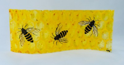 Fused glass panel of honeycomb with bees