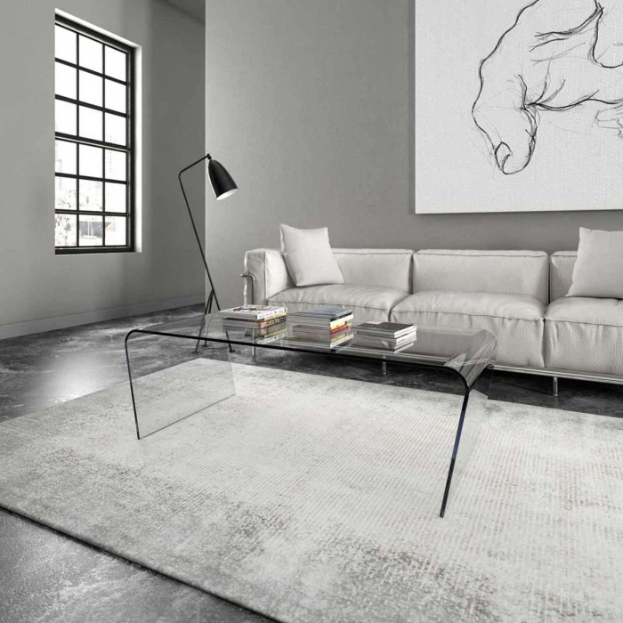 Oblique curved glass coffee table