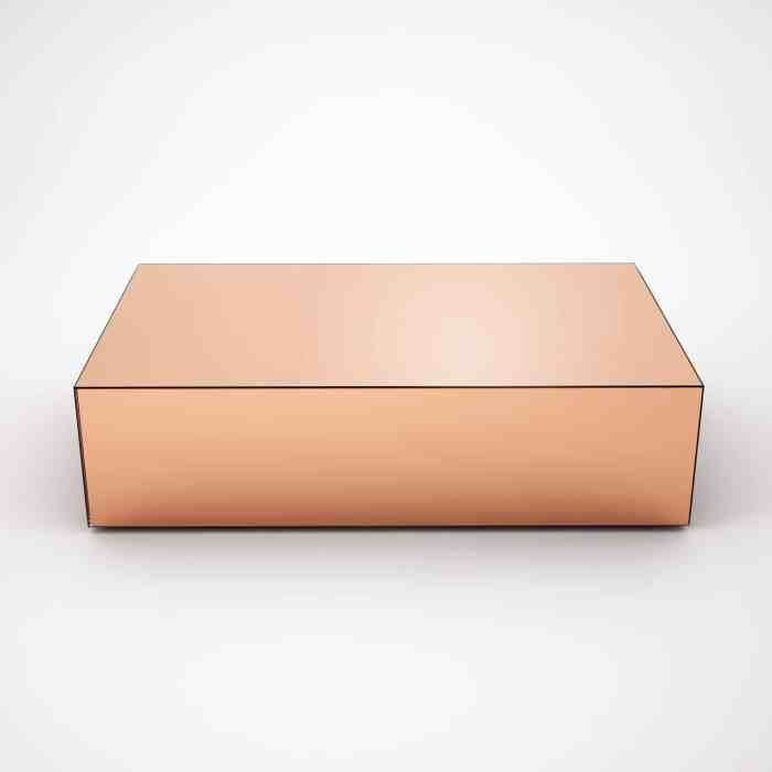 copper coffee table clad in mirror