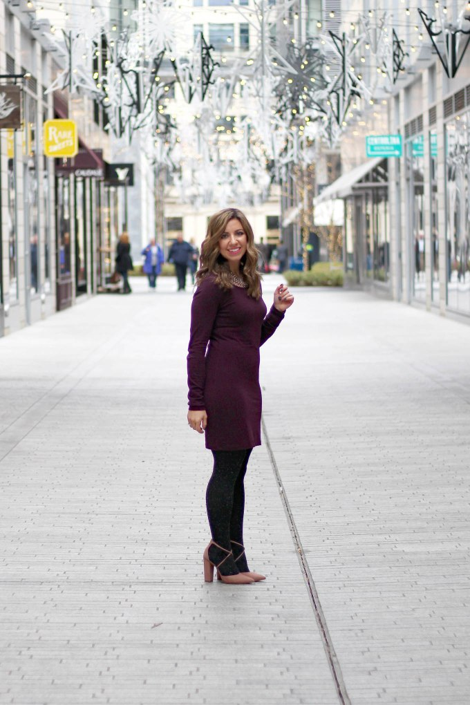Lifestyle Blogger Roxanne Birnbaum of Glass of Glam wearing an H&M jersey dress, Steve Madden heels, BaubleBar necklace, and Express Tights