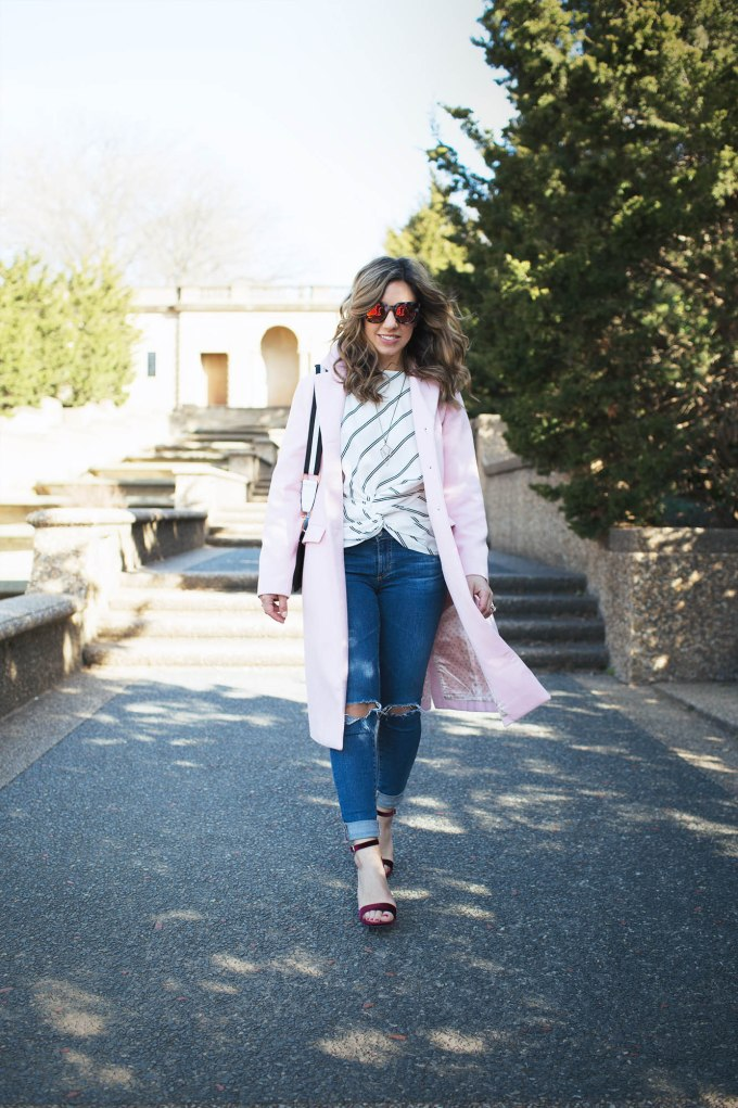 Style Blogger Roxanne Birnbaum of Glass of Glam wearing a SugarLips striped top, AG denim, Amazon Fashion pink coat, a Zaful bag, and Vye Eyewear Sunglasses