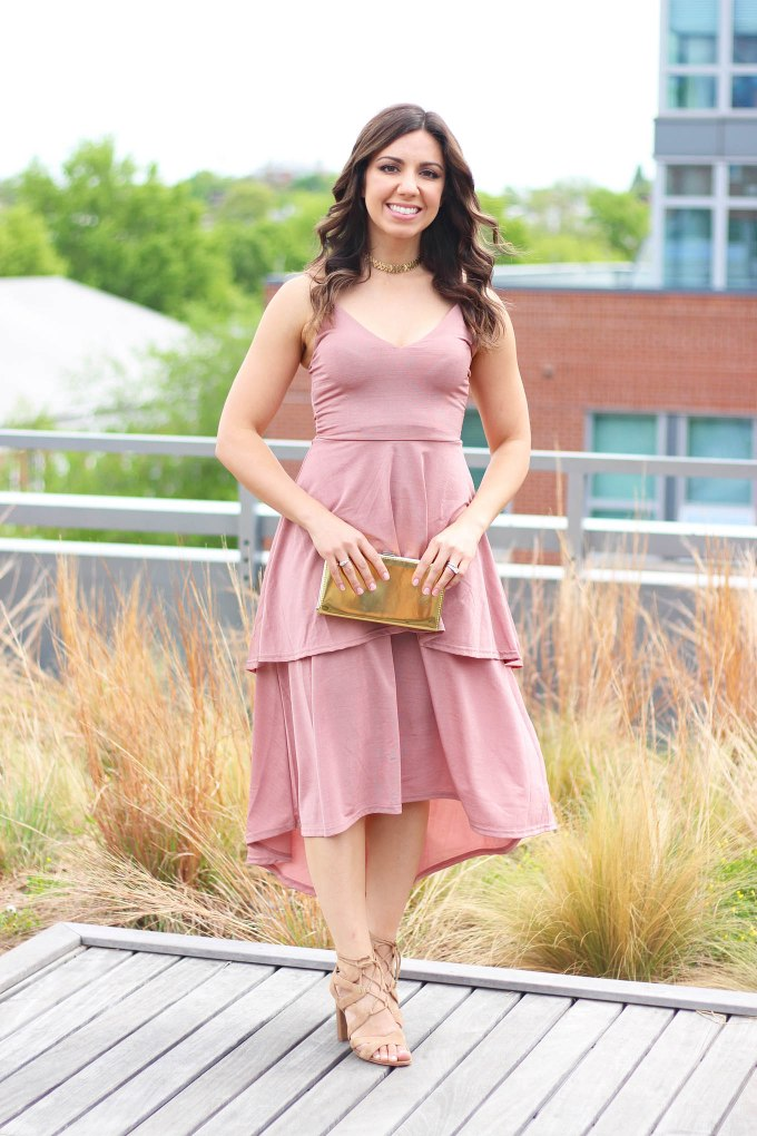 Lifestyle Blogger Roxanne of Glass of Glam wearing a blush Boohoo dress