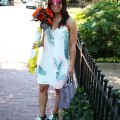 Lifestyle blogger Roxanne of Glass of Glam wearing a shein palm print dress