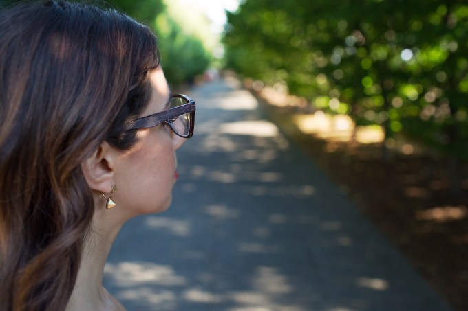 Lifestyle blogger Roxanne of Glass of Glam wearing Optically glasses