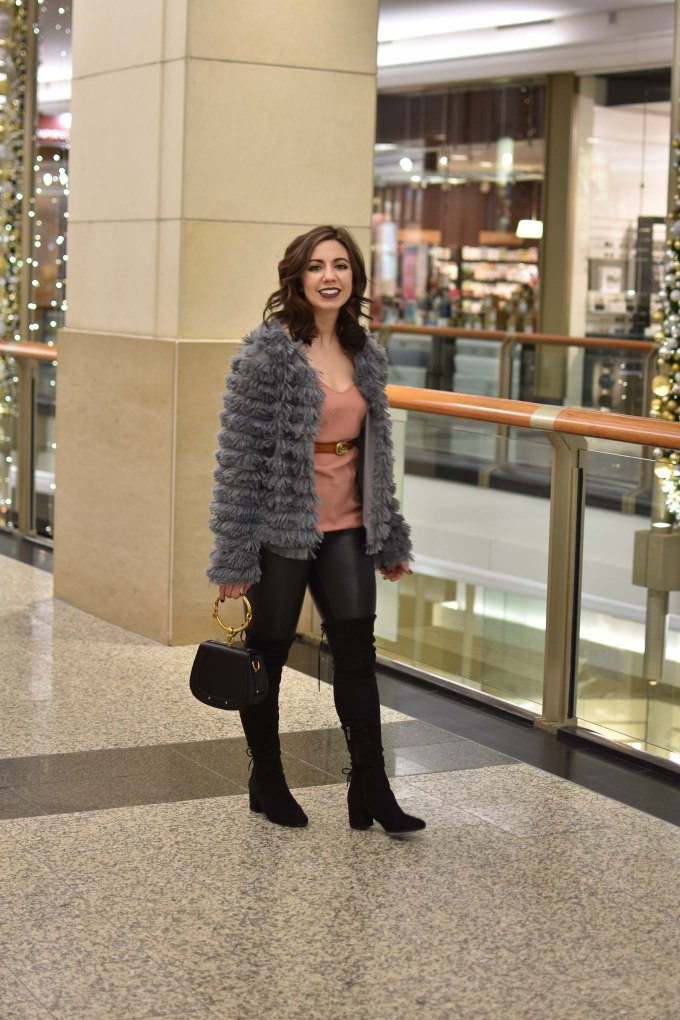 Lifestyle blogger Roxanne of Glass of Glam wearing an Amazon fashion faux fur jacket, faux leather leggings, Chloe Nile bag, otk boots, and Gerard Cosmetics lipstick - Faux Leather leggings by popular Chicago fashion blogger Glass of Glam