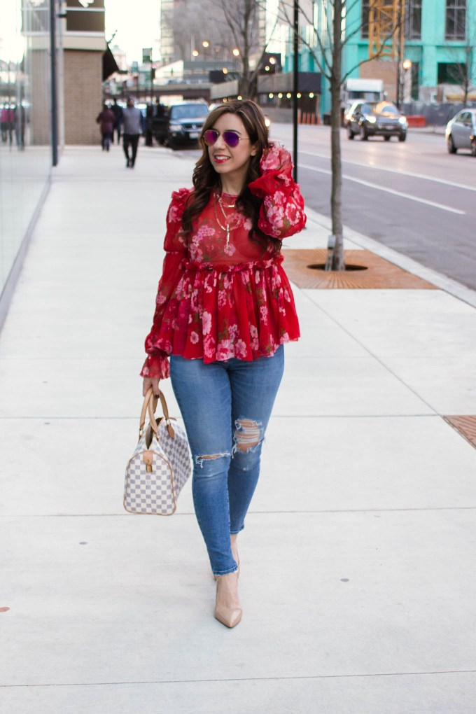 Lifestyle blogger Roxanne of Glass of Glam wearing an Asos ruffle top, Agolde denim, and Sam Edelman pumps