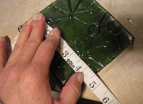 Measuring recycled fused bottle glass