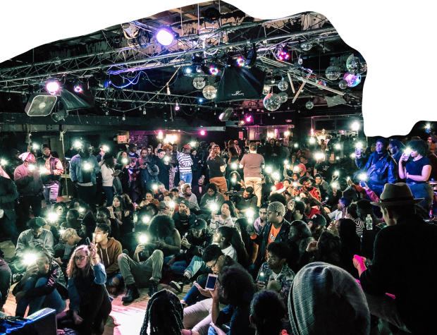 A GLBL VLLG event in an indoor performance space