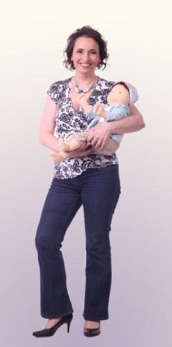 Gledita with babywearing doll