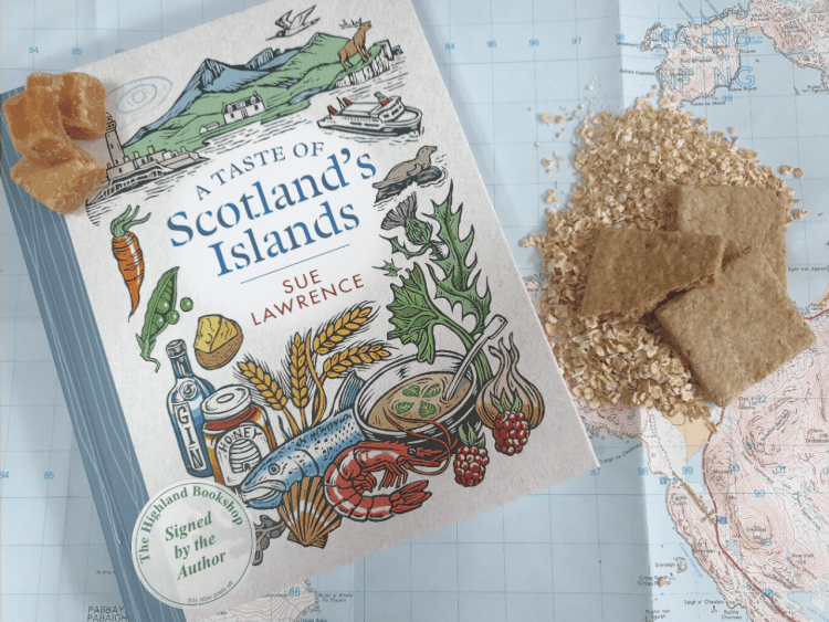 A copy of A Taste of Scotland's Islands with oats, oatcakes and tablet
