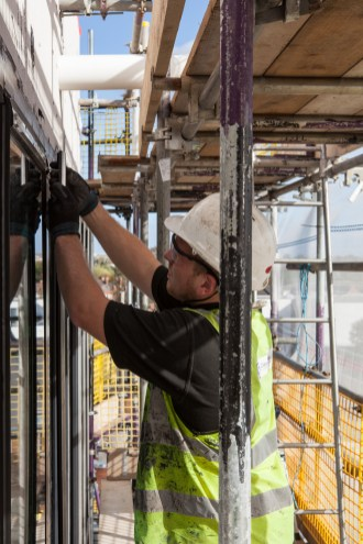 Construction Site Photography - Cladding Installer