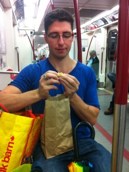 Daniel bought something he was happy to eat on the train.