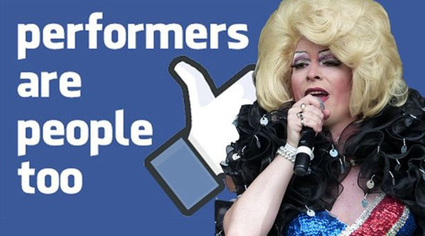 "photo of a Drag Queen in front of a poster in ""Facebook Blue"" that reads ""Performers are people too"""