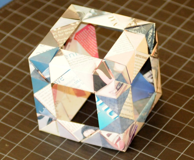 a cube shape made out of folded paper elements