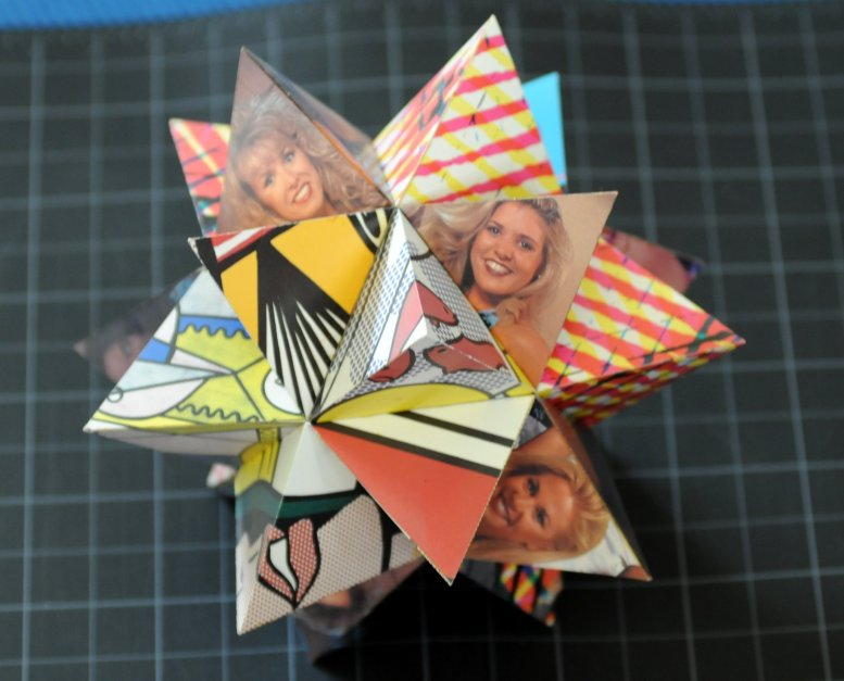 paper model of an icosahedron with each face articulated by a tetrahedron